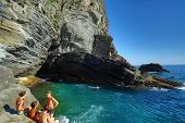 VERNAZZA - ITALY: AUG 17: Swimmers in a cove along the coast of Cinque Terre in Vernazza, Italy, on Sunday, August 17, 2013.
