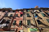 VERNAZZA - ITALY: AUG 17:  Laundry hangs from windows of apartments along the coast of Cinque Terre in Vernazza, Italy, on Sunday, August 17, 2013.
