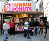 NEW YORK CITY - OCT 20 2013: People line up for coffee and donuts at a Dunkin' Donuts store in Manha
