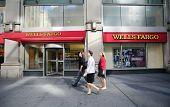 NEW YORK CITY - OCT 24 2013:  Pedestrians walk past a branch office of Wells Fargo & Company bank in