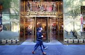 NEW YORK CITY - OCT 20, 2013: Pedestrians walk past a Juicy Couture women's clothing store on 5th Av