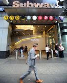 NEW YORK CITY - OCT 17:  Pedestrians walk past the entrance to a New York City subway station in Man