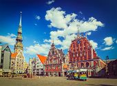 Vintage retro hipster style travel image of  Riga Town Hall Square, House of the Blackheads and St. Peter's Church, Riga, Latvia