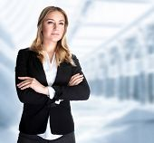 Serious business woman in the office, modern building of great corporate, successful career, smart g