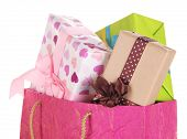Presents in paper bag isolated on white