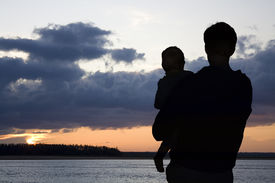 image of father child  - Silhouette of father and child watching sunset - JPG