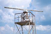 Radar Station Tower Above Blue Cloudy Sky