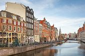 Amsterdam, Netherlands - March 19, 2014: Living Houses Along The Canal Embankment In Spring Day. Ord