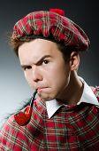 Funny scotsman smoking pipe tobacco