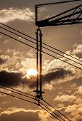 Power Line Pylon And Sun