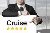 Businessman Pointing On Sign Cruise