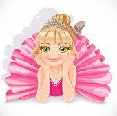 Ballerina girl in pink dress lie on floor