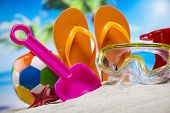 Colorful flip flops on beach