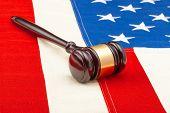 Wooden Judge Gavel Over Us Flag - Closeup Studio Shot