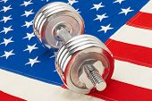 Metal Dumbbell Over Us Flag As Symbol Of Healthy Life Style