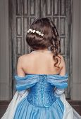 picture of pompous  - Portrait of young beautiful medieval woman in blue dress back - JPG