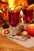 Christmas Mulled Wine - Two Glasses On The Background Of A Burning Fireplace