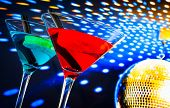 Blue And Red Cocktail With Golden Sparkling Disco Ball Background With Space For Text