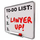 Lawyer Up words written with red marker or pen on a to-do list dry erase board reminding you to hire