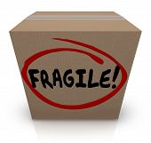 Fragile word written on a cardboard box full of delicate or breakable items to move or ship in the mail