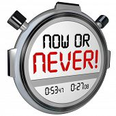 Now or Never words on 3d stopwatch or timer telling you not to procrastinate but take action and succeed at a chance or opportunity
