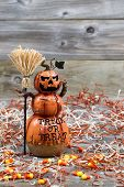Scary Large Orange Pumpkin Ceramic Figure On Weathered Wood