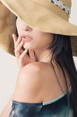 Glamour of Asian beauty with hat, closeup portrait.