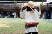 Young Woman  Holding Banyan Branch With A Canvas Bag