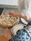 Elderly Woman Preparing Croquettes