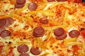 Tasty Pizza Cooked On A Wood-burning Oven With Chips And Wurstel