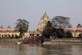 KOLKATA, INDIA - FEB 14: Hindu people bathing in the ghat near the Dakshineswar Kali Temple on February 14, 2014. The beautiful temple was built in Bengal architecture style in 1855