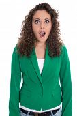 Portrait of an isolated shocked and surprised business woman in green.