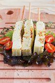 Brazilian Grilled Cheese Snack Queijo Coalho, Tomato, Hydroponic On Cutting Board