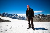 Man On Peak Of Mount Cook In New Zealand