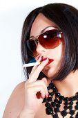 Beauty Woman With Sunglasses Smoking A Cigarette