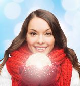 happiness, winter holidays and people concept - smiling young woman in red scarf and mittens with ch