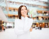 clothing, winter holidays, christmas and people concept - smiling young woman in white sweater over