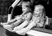 pic of car carrier  - two happy kids in the car  - JPG