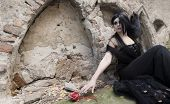 stock photo of cross-dress  - Mysterious woman dressed in black gothic dress - JPG