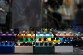 stock photo of pedal  - Guitar effects pedals on the showcases in the music shop - JPG