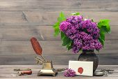 Still Life With Lilac Flowers And Antique Accessories