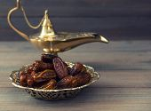 Dates And Golden Arabian Lamp On Wooden Background