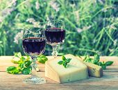 Cheese With Red Wine On Wooden Table Outdoors