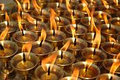 picture of ghee  - Butter candles burning outside of a temple in Kathmandu Nepal - JPG