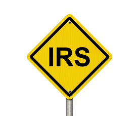 foto of irs  - IRS Warning Sign An American road warning sign with word IRS isolated on a white background - JPG