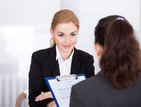 picture of conduction  - Businesswoman Conducting An Employment Interview With Young Female Applicant - JPG