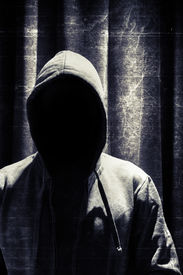picture of incognito  - Portrait of incognito man under hood with grunge curtain background - JPG