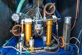 stock photo of air compressor  - A close up look at a  Scuba Tank Air Compressor - JPG