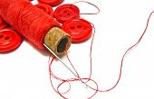Spool Of Thread And Red Buttons
