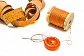 Orange Spool Of Thread, Meter And Button